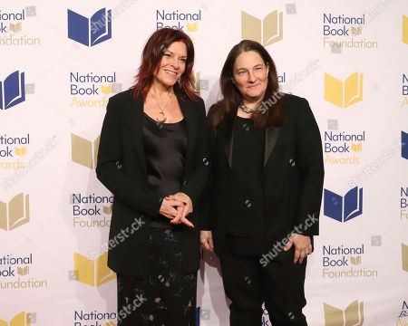 Stock Picture of Rosanne Cash, A.M Homes. Rosanne Cash, left, and A.M Homes attend the 70th National Book Awards ceremony and benefit dinner at Cipriani Wall Street, in New York