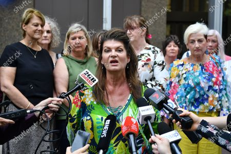 Claimant Julie Davis (C) speaks on behalf of victims after the ruling was announced in a transvaginal mesh device class action, outside the Federal Court in Sydney, Australia, 21 November 2019. A class action against companies owned by Johnson & Johnson by more than 700 women was won on 21 November 2019.