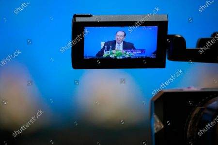 World Bank President David Malpass is seen on a video camera screen during a press conference at the Fourth 1+6 Round Table Dialogue at Diaoyutai State Guest House in Beijing, China, 21 November 2019. Chinese Prime Minister Li Keqiang and leading officials from major international financial organizations attended the event for discussions on global economic trends, macro policies coordination and China's economic reform and global economic governance.