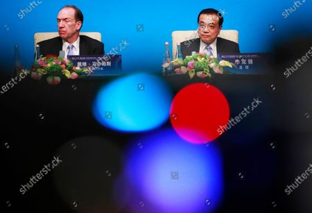 Chinese Prime Minister Li Keqiang (R) and World Bank President David Malpass (L) attend a press conference at the Fourth 1+6 Round Table Dialogue at Diaoyutai State Guest House in Beijing, China, 21 November 2019. Li Keqiang and leading officials from major international financial organizations attended the event for discussions on global economic trends, macro policies coordination and China's economic reform and global economic governance.
