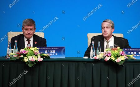 International Labor Organization (ILO) Director-General Guy Ryder (L), and Financial Stability Board (FSB) Chairman Randal K. Quarles attend a press conference at the Fourth 1+6 Round Table Dialogue at Diaoyutai State Guest House in Beijing, China, 21 November 2019. Chinese Prime Minister Li Keqiang and leading officials from major international financial organizations attended the event for discussions on global economic trends, macro policies coordination and China's economic reform and global economic governance.
