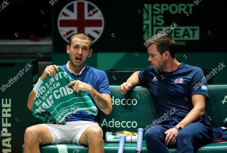Dan Evans of Great Britain dejected next to captain Leon Smith versus Kazakhstan