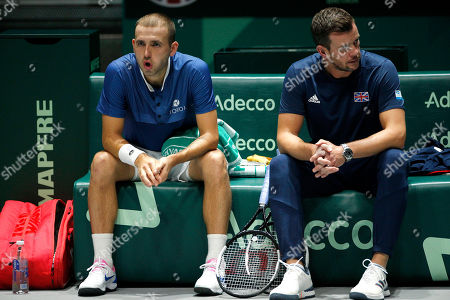 Dan Evans of Great Britain sits frustrated next to Captain Leon Smith versus Kazakhstan