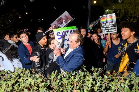 """Stock Image of Protesters confront a man leaving a speech by conservative commentator Ann Coulter at the University of California, Berkeley, in Berkeley, Calif. Hundreds of demonstrators gathered as Coulter delivered a talk titled """"Adios, America"""
