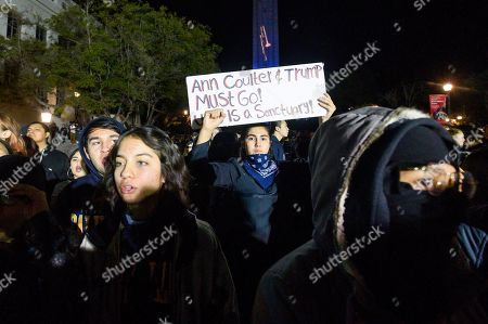 """University of California, Berkeley student Magaly Mercado joins protesters outside a speech by conservative commentator Ann Coulter, in Berkeley, Calif. Hundreds of demonstrators gathered on campus as Coulter delivered a talk titled """"Adios, America"""