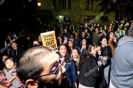 """Protesters yell at audience members leaving a speech by conservative commentator Ann Coulter, in Berkeley, Calif. Hundreds of demonstrators gathered on campus as Coulter delivered a talk titled """"Adios, America"""