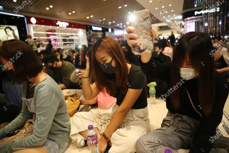 Pro-democracy protesters attend a sit in at a mall in Yuen Long, Hong Kong, China, 21 November 2019. The protesters were marking the fourth month since an assault carried out by a group of white-clad men targeted protesters and passengers in the Yuen Long MTR station on 21 July 2019. Hong Kong is in its sixth month of mass protests, which were originally triggered by a now withdrawn extradition bill, and have since turned into a wider pro-democracy movement.