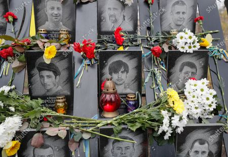 Flowers and candles are seen at the memorial for Maidan activists or 'Heroes of the Heavenly Hundred', who were killed on the Maidan during anti-government protests in 2014, not far from Independence Square in Kiev, Ukraine, 21 November 2019. Ukrainians marked the anniversary of the Euromaidan revolution, commemorating 21 November 2013, on which activists started an anti-government picket after then-Prime Minister Mykola Azarov announced the suspension of a landmark treaty with the European Union. The protests eventually led to the ouster of President Viktor Yanukovych, creating political rifts through the country that erupted into a violent conflict between separatists and government forces in the eastern part of the country in the spring.