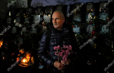 Ukrainians lay flowers at the memorial for Maidan activists or 'Heroes of the Heavenly Hundred', who were killed on the Maidan during anti-government protests in 2014, not far from Independence Square in Kiev, Ukraine, 21 November 2019. Ukrainians marked the anniversary of the Euromaidan revolution, commemorating 21 November 2013, on which activists started an anti-government picket after then-Prime Minister Mykola Azarov announced the suspension of a landmark treaty with the European Union. The protests eventually led to the ouster of President Viktor Yanukovych, creating political rifts through the country that erupted into a violent conflict between separatists and government forces in the eastern part of the country in the spring.