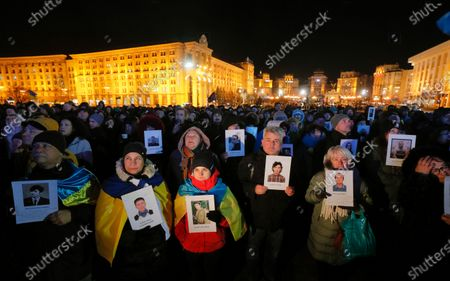 Ukrainians hold portraits of the Maidan activists, who were killed on the Maidan during anti-government protests in 2014, during a rally on the Independence Square in Kiev, Ukraine, 21 November 2019. Ukrainians marked the anniversary of the Euromaidan revolution, commemorating 21 November 2013, on which activists started an anti-government picket after then-Prime Minister Mykola Azarov announced the suspension of a landmark treaty with the European Union. The protests eventually led to the ouster of President Viktor Yanukovych, creating political rifts through the country that erupted into a violent conflict between separatists and government forces in the eastern part of the country in the spring.