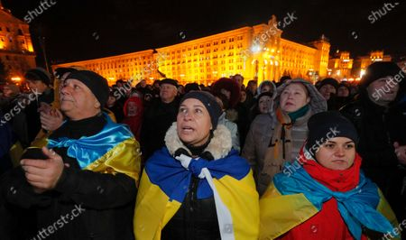 Ukrainians covered by Nnational flags attend a rally on the Independence Square in Kiev, Ukraine, 21 November 2019. Ukrainians marked the anniversary of the Euromaidan revolution, commemorating 21 November 2013, on which activists started an anti-government picket after then-Prime Minister Mykola Azarov announced the suspension of a landmark treaty with the European Union. The protests eventually led to the ouster of President Viktor Yanukovych, creating political rifts through the country that erupted into a violent conflict between separatists and government forces in the eastern part of the country in the spring.