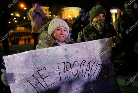 Ukrainian woman holds a map of Ukraine signed with slogan 'Not for sale', during a rally on the Independence Square in Kiev, Ukraine, 21 November 2019. Ukrainians marked the anniversary of the Euromaidan revolution, commemorating 21 November 2013, on which activists started an anti-government picket after then-Prime Minister Mykola Azarov announced the suspension of a landmark treaty with the European Union. The protests eventually led to the ouster of President Viktor Yanukovych, creating political rifts through the country that erupted into a violent conflict between separatists and government forces in the eastern part of the country in the spring.