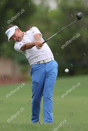 Stock Picture of Ian Poulter of England plays a shot on the 3rd hole during the first round of the DP World Tour Championship golf tournament in Dubai, United Arab Emirates