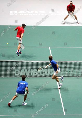 Stock Image of France's tennis players Pierre Hugues Herbert (L front) and Nicolas Mahut (R front) return the ball to Serbia's Janko Tipsarevic (L back) and Viktor Troicki (R back) during the quarterfinals of the Davis Cup Madrid Finals held at the Caja Magica tennis venue in Madrid, Spain, 21 November 2019.