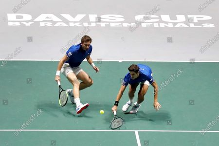France's tennis players Pierre Hugues Herbert (R) and Nicolas Mahut (L) return the ball to Serbia's Janko Tipsarevic and Viktor Troicki during the quarterfinals of the Davis Cup Madrid Finals held at the Caja Magica tennis venue in Madrid, Spain, 21 November 2019.