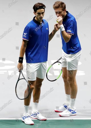 Stock Photo of France's tennis players Pierre Hugues Herbert (L) and Nicolas Mahut (R) react during their quarterfinals doubles match of the Davis Cup Madrid Finals against Serbia's Janko Tipsarevic and Viktor Troicki, held at the Caja Magica tennis venue in Madrid, Spain, 21 November 2019.