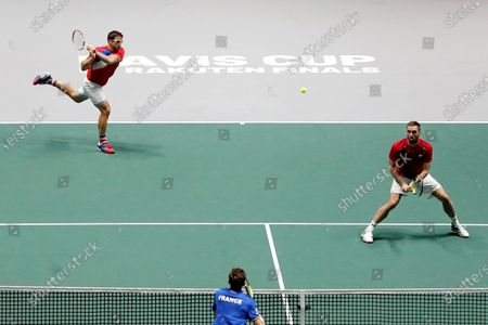 Serbia's tennis players Janko Tipsarevic (L) and Viktor Troicki (R) return the ball to France's Pierre Hugues Herbert (C) and Nicolas Mahut (unseen) during the quarterfinals of the Davis Cup Madrid Finals held at the Caja Magica tennis venue in Madrid, Spain, 21 November 2019.