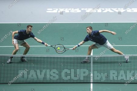 Britain's  Jamie Murray (L) and Neal Skupski (R) in action during the double match against Kazakhstan's Mikhail Kukushkin and Alexander Bublik in the quarterfinals of the Davis Cup Madrid Finals held at the Caja Magica tennis venue in Madrid, Spain, 21 November 2019.