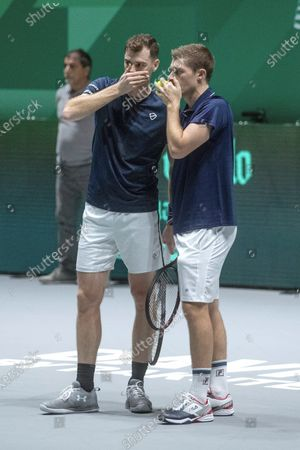 Britain's Jamie Murray (L) and Neal Skupski (R) react during the double match against Kazakhstan's Mikhail Kukushkin and Alexander Bublik in the quarterfinals of the Davis Cup Madrid Finals held at the Caja Magica tennis venue in Madrid, Spain, 21 November 2019.