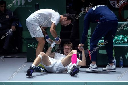 Kazakhstan's Mikhail Kukushkin (L) and Alexander Bublik (C) react during the double match against Britain's Jamie Murray and Neal Skupski in the quarterfinals of the Davis Cup Madrid Finals held at the Caja Magica tennis venue in Madrid, Spain, 21 November 2019.