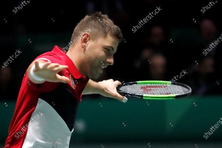 Serbia's Filip Krajinovic celebrates his victory over France's Jo-Wilfred Tsonga in the quarterfinals of the Davis Cup Madrid Finals held at the Caja Magica tennis venue in Madrid, Spain, 21 November 2019.