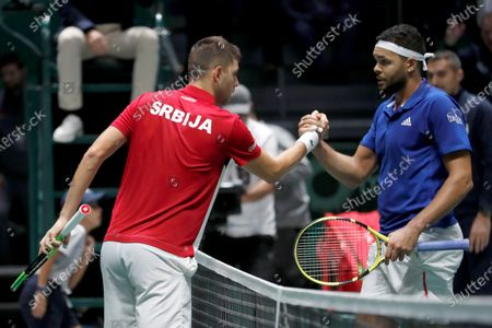 Serbia's Filip Krajinovic (L) greets France's Jo-Wilfred Tsonga (R) at the end of their match in the quarterfinals of the Davis Cup Madrid Finals held at the Caja Magica tennis venue in Madrid, Spain, 21 November 2019.