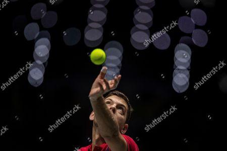 Serbia's Filip Krajinovic serves to France's Jo-Wilfried Tsonga during their Davis Cup tennis match in Madrid, Spain