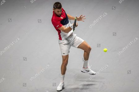 Stock Picture of Serbia's Filip Krajinovic returns the ball to France's Jo-Wilfried Tsonga during their Davis Cup tennis match in Madrid, Spain