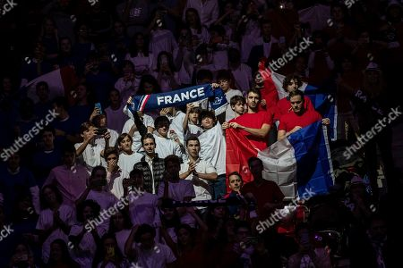 EDS NOTE : SPANISH LAW REQUIRES THAT THE FACES OF MINORS ARE MASKED IN PUBLICATIONS WITHIN SPAIN France supporters cheer during the Davis Cup tennis match between Jo-Wilfried Tsonga and Serbia's Filip Krajinovic in Madrid, Spain