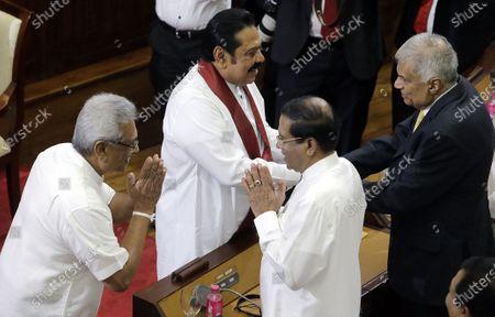 Sri Lankan President Gotabaya Rajapaksa (L) and his brother, new Prime Minister Mahinda Rajapaksa (C-L) greet former Sri Lankan president Maithripala Sirisena (C-R) and former Prime Minister Ranil Wickremesinghe (R) at the presidential secretariat in Colombo Sri Lanka, 21 November 2019. Mahinda Rajapaksa was sworn-in as Prime Minister on 21 November after his brother's victory in the Sri Lanka presidential election held on 16 November 2019.