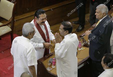 Stock Picture of Sri Lankan President Gotabaya Rajapaksa (L) and his brother, new Prime Minister Mahinda Rajapaksa (C-L) greet former Sri Lankan president Maithripala Sirisena (C-R) and former Prime Minister Ranil Wickremesinghe (R) at the presidential secretariat in Colombo Sri Lanka, 21 November 2019. Mahinda Rajapaksa was sworn-in as Prime Minister on 21 November after his brother's victory in the Sri Lanka presidential election held on 16 November 2019.