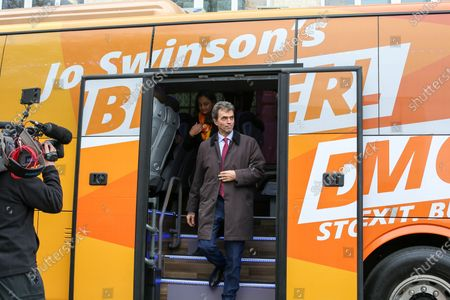 Liberal Democrat Shadow Brexit Secretary, Tom Brake and London Mayoral candidate, Siobhan Benita  arrives at Karamel Cafe - a creative regeneration charity in Hornsey and Wood Green, north London in Liberal Democrats' campaign bus.