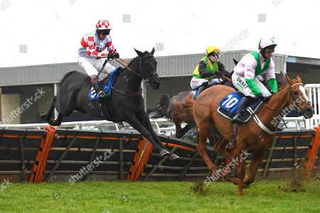 Umndeni ridden by Richard Johnson and trained by Phiilip Hobbs clear the last in The Smith and Williamson Bloodstock Tax & Advisory Services Handicap Hurdle Midnight Midge ridden by Bryan Carver and trained by Chris Down  during Horse Racing at Wincanton Racecourse on 21st November 2019