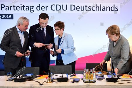 Stock Picture of (L-R) Christian Democratic Union (CDU) vice-chairman Thomas Strobl, Christian Democratic Union (CDU) Secretary General Paul Ziemiak, Christian Democratic Union (CDU) party chairwoman Annegret Kramp-Karrenbauer Look on tablets next to German Chancellor Angela Merkel (R) during the beginning of a chair board meeting a day before the start of the Party Congress of the Christian Democratic Union (CDU) in Leipzig, Germany, 21 November 2019. CDU Party Congress takes place from 22 to 23 November 2019.