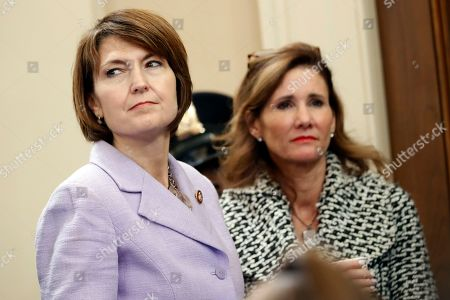 Rep. Cathy McMorris Rodgers, R-Wash., listens as former White House national security aide Fiona Hill, and David Holmes, a U.S. diplomat in Ukraine, testify before the House Intelligence Committee on Capitol Hill in Washington, during a public impeachment hearing of President Donald Trump's efforts to tie U.S. aid for Ukraine to investigations of his political opponents