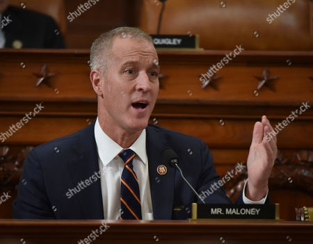 Rep. Sean Patrick Maloney, D-N.Y., questions former White House national security aide Fiona Hill, and David Holmes, a U.S. diplomat in Ukraine, as they testify before the House Intelligence Committee on Capitol Hill in Washington, during a public impeachment hearing of President Donald Trump's efforts to tie U.S. aid for Ukraine to investigations of his political opponents
