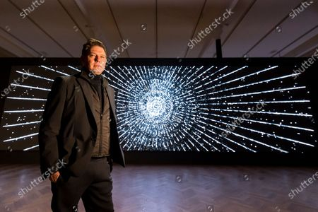 American artist Leo Villareal poses by his work 'Detector', 2019, at a preview of his first solo exhibition at Pace gallery in Mayfair