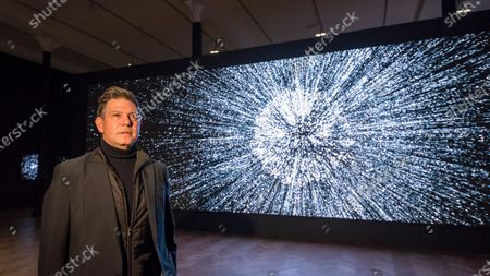 Stock Image of American artist Leo Villareal poses by his work 'Detector', 2019, at a preview of his first solo exhibition at Pace gallery in Mayfair