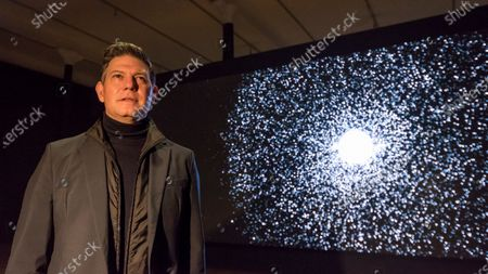 Stock Picture of American artist Leo Villareal poses by his work 'Detector', 2019, at a preview of his first solo exhibition at Pace gallery in Mayfair