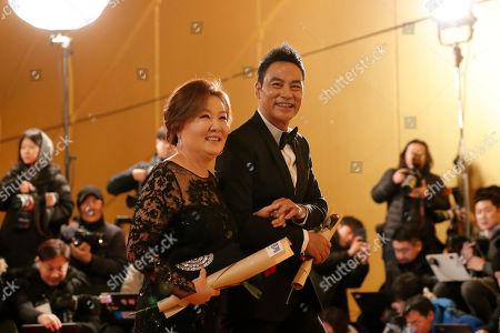 Simon Yam, Kim Hye-sook. Hong Kong actor Simon Yam, right, and South Korean actress Kim Hye-sook arrive at the 40th Blue Dragon Film Awards in Incheon, South Korea