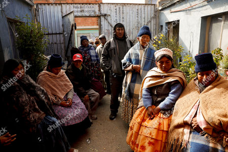Mourners gather for the wake of Ruddy Vasquez killed during clashes between security forces and anti-government protesters, at his home in El Alto, on the outskirts of La Paz, Bolivia, . At least eight people were killed Tuesday when police and soldiers cleared a blockade of a fuel plant by supporters of former President Evo Morales at protesters in the city of El Alto