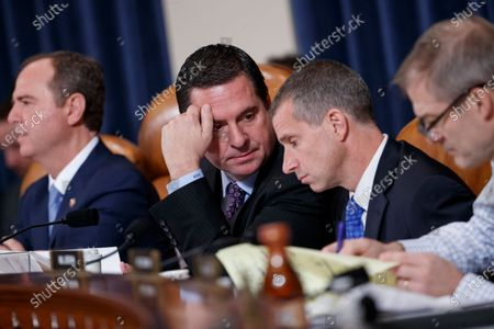 Ranking member of the House Permanent Select Committee on Intelligence Devin Nunes (L) talks with Republican legal counsel Steve Castor (R) during the House Permanent Select Committee on Intelligence public hearing on the impeachment inquiry into US President Donald J. Trump, on Capitol Hill in Washington, DC, USA, 21 November 2019. The impeachment inquiry is being led by three congressional committees and was launched following a whistleblower's complaint that alleges US President Donald J. Trump requested help from the President of Ukraine to investigate a political rival, Joe Biden and his son Hunter Biden.