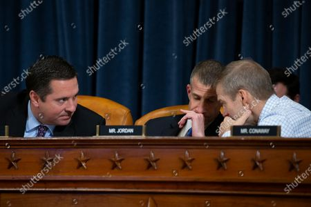 Republican Representative from California Devin Nunes (L), counsel for the minority Steve Castor (C) Republican Representative from Ohio Jim Jordan (R) speak with one another before the end of the House Permanent Select Committee on Intelligence public hearing on the impeachment inquiry into US President Donald J. Trump, on Capitol Hill in Washington, DC, USA, 21 November 2019. The impeachment inquiry is being led by three congressional committees and was launched following a whistleblower's complaint that alleges US President Donald J. Trump requested help from the President of Ukraine to investigate a political rival, Joe Biden and his son Hunter Biden.