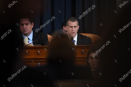 US Representative Devin Nunes (R-CA), left, looks on as counsel, Steve Castor asks questions of Dr. Fiona Hill, former National Security Council senior director for Europe and Russia as she and David A. Holmes, Department of State political counselor for the United States Embassy in Kyiv, Ukraine appear before the House Intelligence Committee during an impeachment inquiry hearing at the Longworth House Office Building in Washington, D.C., USA, 21 November 2019.