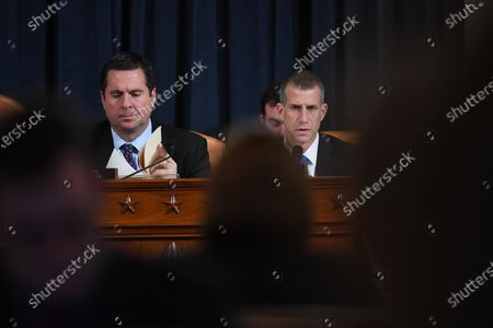 US Representative Devin Nunes (R-CA), left, looks on as minority counsel, Steve Castor asks questions of Dr. Fiona Hill, former National Security Council senior director for Europe and Russia as she and David A. Holmes, Department of State political counselor for the United States Embassy in Kyiv, Ukraine appear before the House Intelligence Committee during an impeachment inquiry hearing at the Longworth House Office Building in Washington, D.C., USA, 21 November 2019.