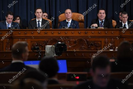 House Intelligence Committee chair, Adam Schiff (D-CA) (C) looks on as US Representative Devin Nunes (R-CA), second from right, speaks as David A. Holmes, Department of State political counselor for the United States Embassy in Kyiv, Ukraine and Dr. Fiona Hill, former National Security Council senior director for Europe and Russia appear before the House Intelligence Committee during an impeachment inquiry hearing at the Longworth House Office Building in Washington, D.C., USA, 21 November 2019.