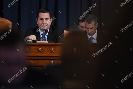 US Representative Devin Nunes (R-CA), left, speaks as minority counsel, Steve Castor is seen at right as Nunes questions Dr. Fiona Hill, former National Security Council senior director for Europe and Russia as she and David A. Holmes, Department of State political counselor for the United States Embassy in Kyiv, Ukraine appear before the House Intelligence Committee during an impeachment inquiry hearing at the Longworth House Office Building in Washington, D.C., USA, 21 November 2019.