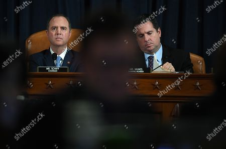 House Intelligence Committee chair, Adam Schiff (D-CA) and U.S. Representative Devin Nunes (R-CA) are seen as David A. Holmes, Department of State political counselor for the United States Embassy in Kyiv, Ukraine and Dr. Fiona Hill, former National Security Council senior director for Europe and Russia appear before the House Intelligence Committee during an impeachment inquiry hearing at the Longworth House Office Building in Washington, D.C., USA, 21 November 2019. The impeachment inquiry is being led by three congressional committees and was launched following a whistleblower's complaint that alleges US President Donald J. Trump requested help from the President of Ukraine to investigate a political rival, Joe Biden and his son Hunter Biden.