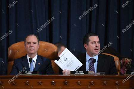 House Intelligence Committee chair, Adam Schiff (D-CA) looks on as U.S. Representative Devin Nunes (R-CA) speaks as David A. Holmes, Department of State political counselor for the United States Embassy in Kyiv, Ukraine and Dr. Fiona Hill, former National Security Council senior director for Europe and Russia appear before the House Intelligence Committee during an impeachment inquiry hearing at the Longworth House Office Building in Washington, DC, USA, 21 November 2019.