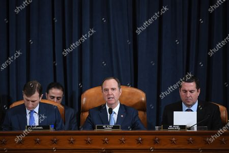 (L-R) Counsel, Daniel Goldman, looks on as House Intelligence Committee chair, Adam Schiff (D-CA) speaks while U.S. Representative Devin Nunes (R-CA) is seen at right as David A. Holmes, Department of State political counselor for the United States Embassy in Kyiv, Ukraine and Dr. Fiona Hill, former National Security Council senior director for Europe and Russia appear before the House Intelligence Committee during an impeachment inquiry hearing at the Longworth House Office Building in Washington, DC, USA, 21 November 2019.